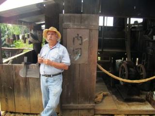 """Explaining coffee processing at the Uchida farm"" Photo by Marcia Kemble"