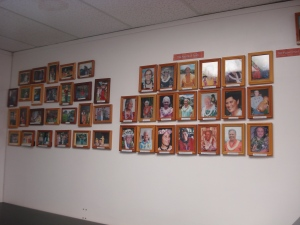 Photographs of hula elders that have contributed materials and shared manaʻo through oral history adorn the wall of the HPS archive.