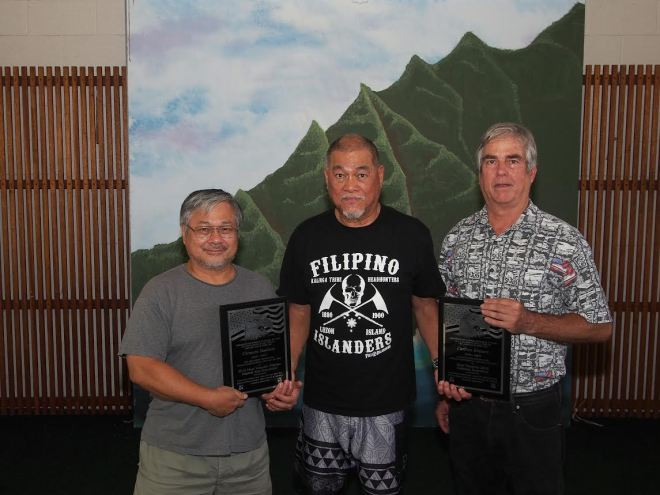Richard Bustillo (center) presents United States Martial Arts Hall of Fame awards recognizing eFIL administrator Clement Bautista (left) and General Ablen School of Derobio Escrima Senior Master Carlton Kramer (right) for their efforts to document Hawaii's past and present masters of eskrima.