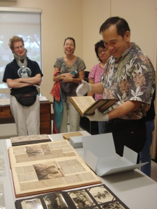 Provincial Archivist Stuart Ching reads excerpts from a journal chronicling the activities of Sacred Hearts missionaries to Hawai`i.