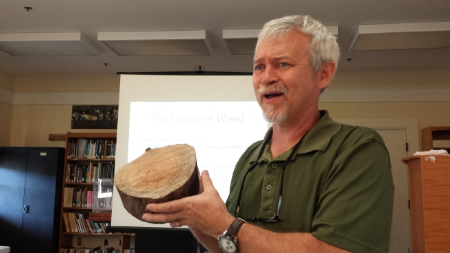 Curtis demonstrates the nature of wood. Photo Credit: J. Sommer