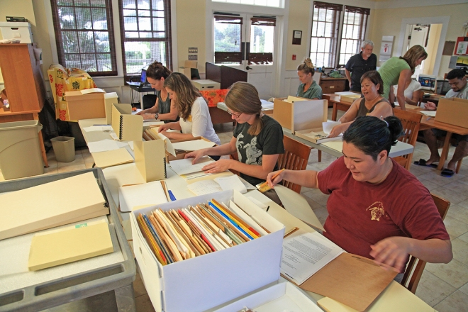 Participants working with some of the park's archival collections. Photo Credit: NPS/S. Williams.