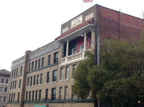 Association buildings in Chinatown have decorative balconies to let the community and new immigrants know its presence.