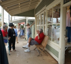 Gail Ainsworth shows AHA historic buildings in the town